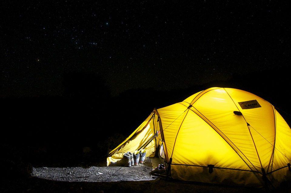 camp tent under stars